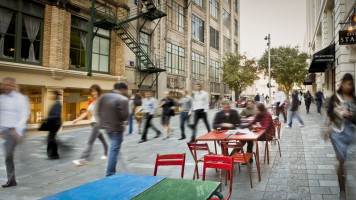Auckland City Street - blurred images of people sitting outside on a pedestrian friendly city lane